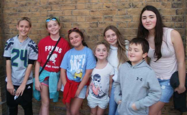 Terrie Farley Moran with her seven grandchildren